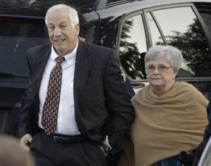 "FILE - In this Dec. 13, 2011 file photo, former Penn State assistant football coach Jerry Sandusky arrives with his wife, Dottie Sandusky, for a preliminary hearing at the Centre County Courthouse in Bellefonte, Pa. Dottie Sandusky says it was long after he'd been arrested, tried and convicted before she realized just how much trouble the former Penn State assistant football coach had gotten himself into. In an interview this week at her home in State College, Dottie Sandusky said that even after his 45-count guilty verdict in the child molestation case, she still had had hope. But when the judge gave him to 30 to 60 years in state prison, she said, she fully comprehended the trouble he was in. She's been granting interviews in recent weeks, arguing her husband's conviction was unjust and claiming the victims who testified against him told inaccurate stories to cash in. An attorney involved in negotiating with Penn State on behalf of his victims calls her denials ""obscene."" (AP Photo/Gene J. Puskar, File)"